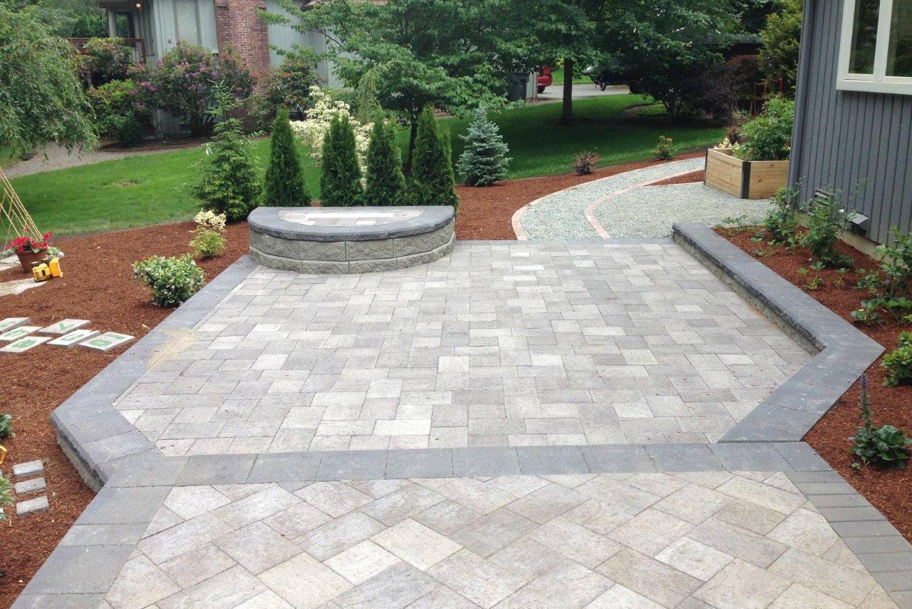 Image of a creative paver path next to a house created as part of Hoffman's paver and driveway installation services.